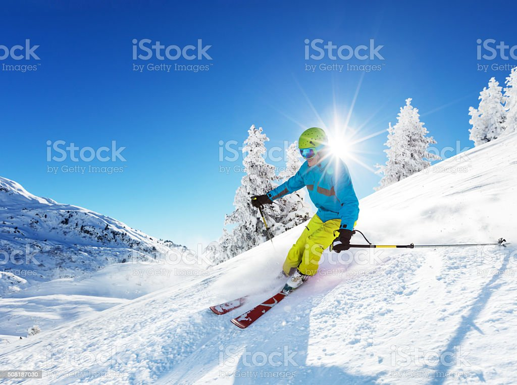 Man skier running downhill stock photo