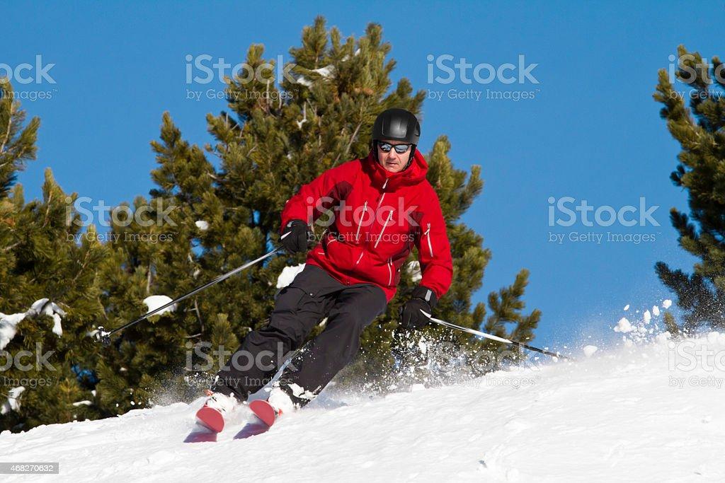 Man skiing backcountry stock photo