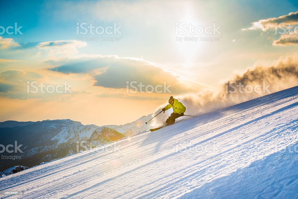 Man skiing downhill stock photo