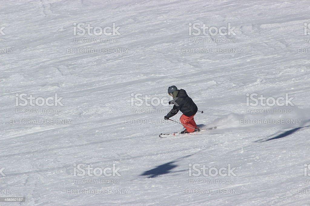 Man skiing fast at ski station CERRO CATEDRAL royalty-free stock photo