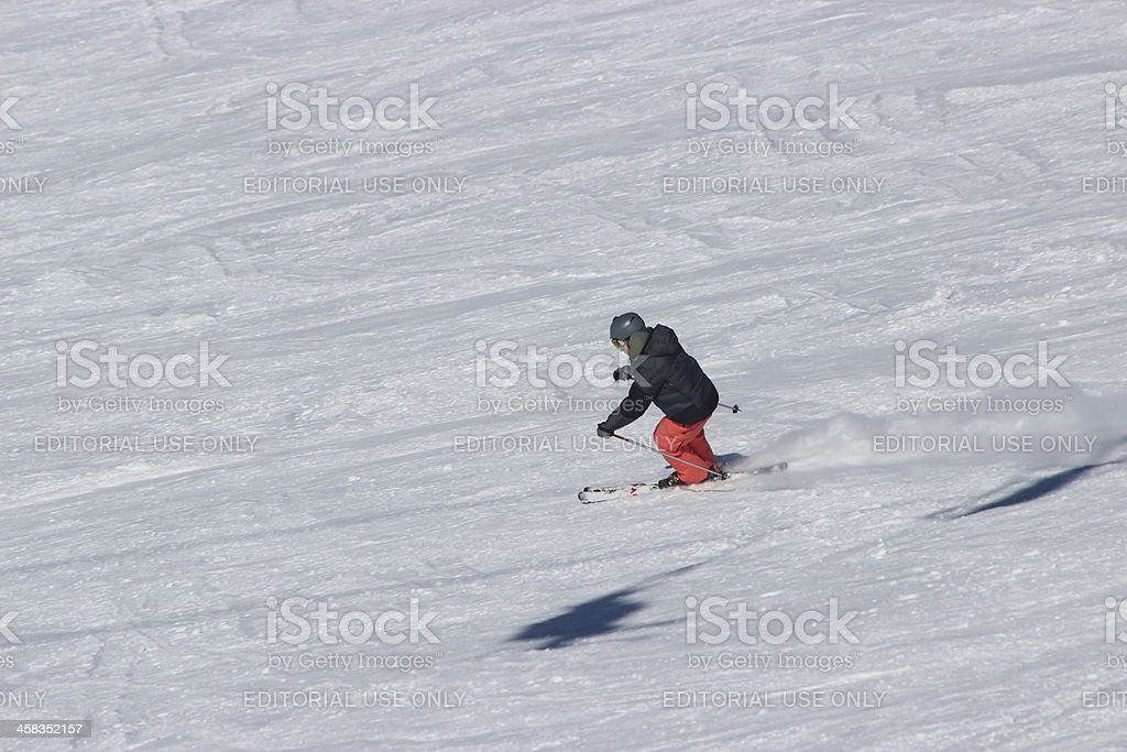Man skiing fast at ski station CERRO CATEDRAL stock photo