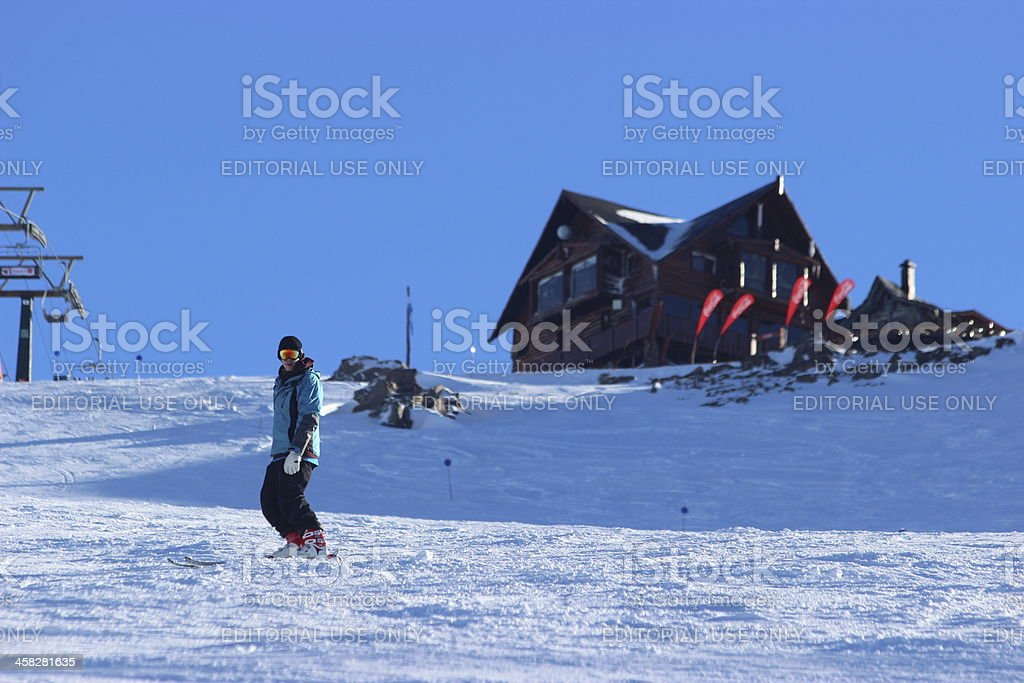Man skiing in front of Lynch Refuge - Andes Patagonia stock photo