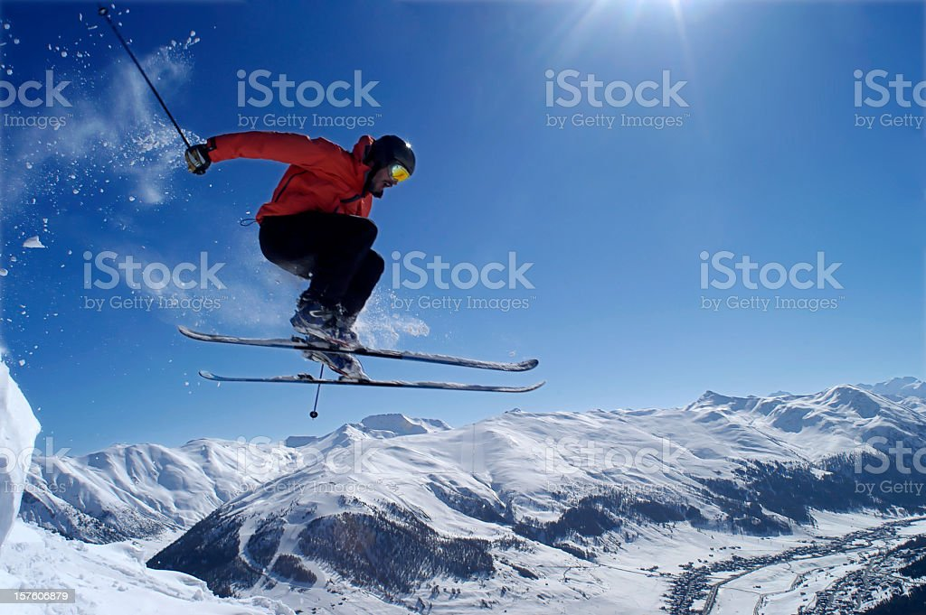 Man skiing in the mountains doing a jump trick royalty-free stock photo