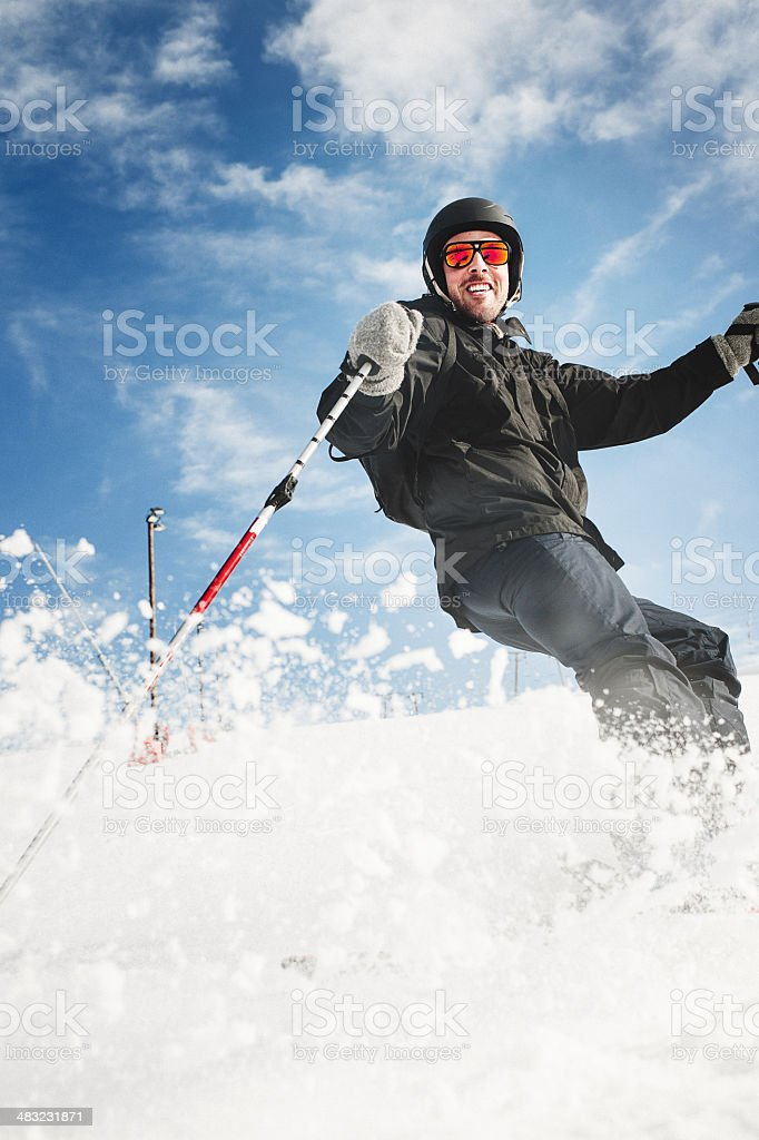 Man skiing in the ski slope stock photo
