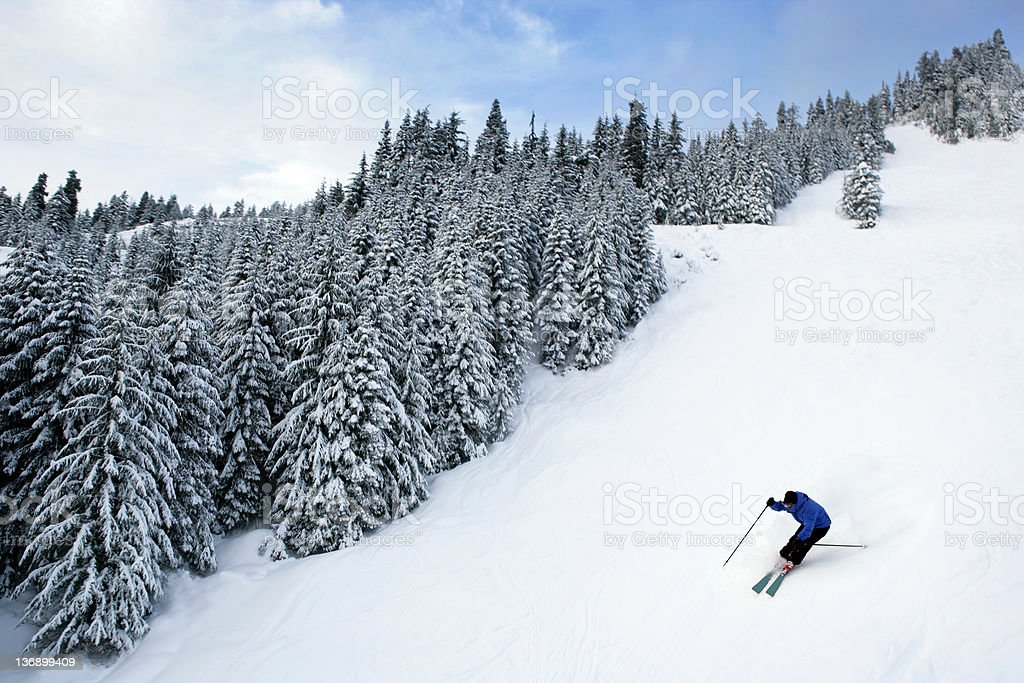man skiing on steep trail stock photo