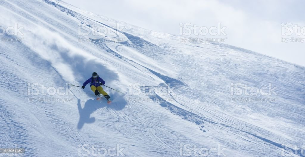 Man skiing stock photo
