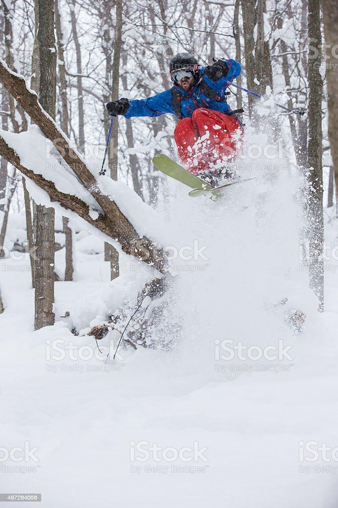 Man skiing powder snow stock photo