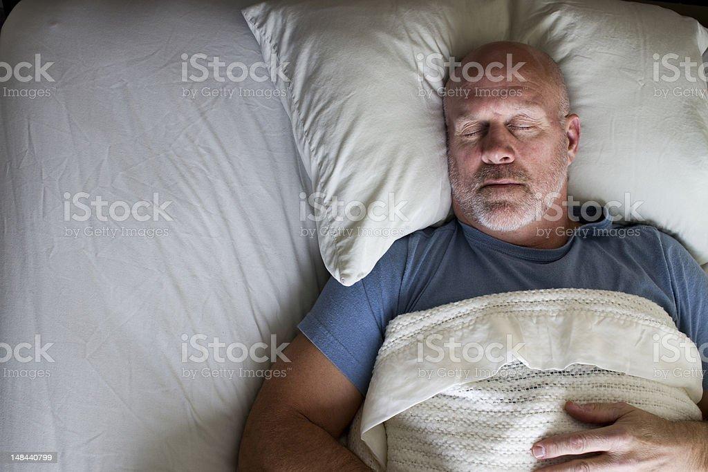 Man Sleeping in Bed stock photo