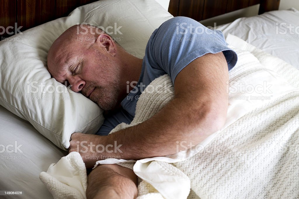 Man Sleeping in Bed royalty-free stock photo