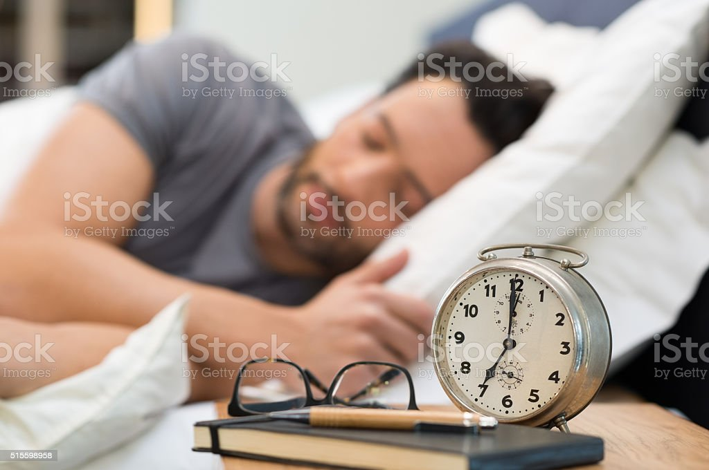Man sleeping in bed stock photo