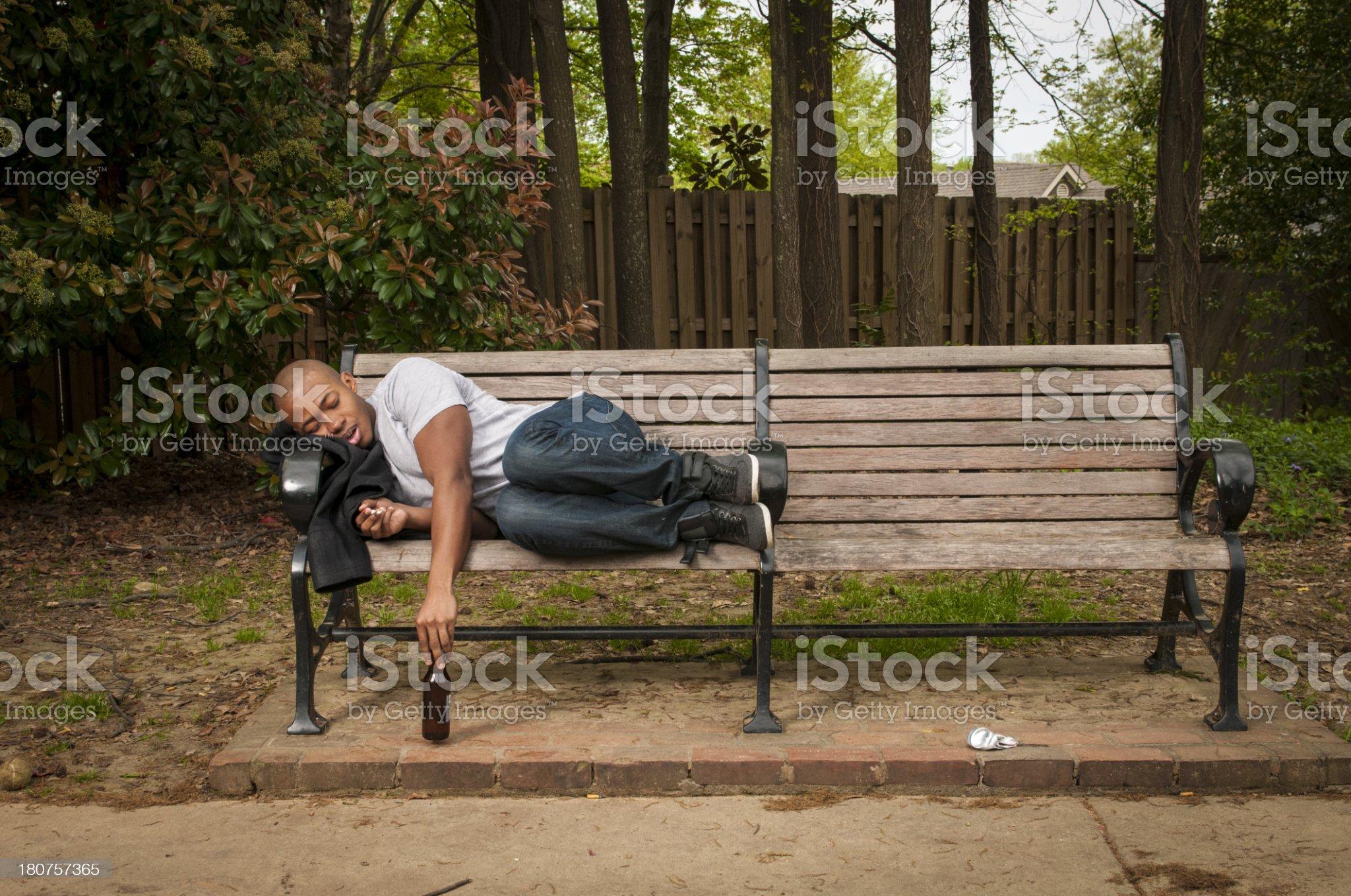 Man Sleeping on Park Bench royalty-free stock photo