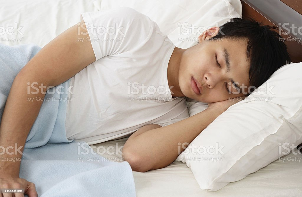 Man sleeping stock photo