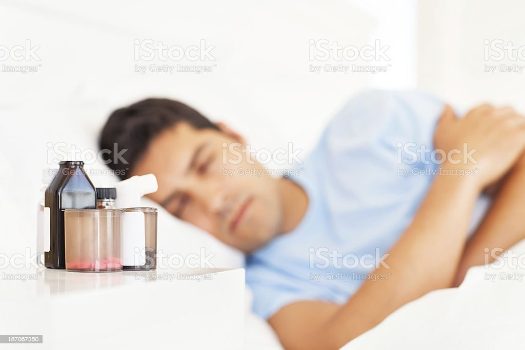 Man Sleeping With Focus On Medicines royalty-free stock photo