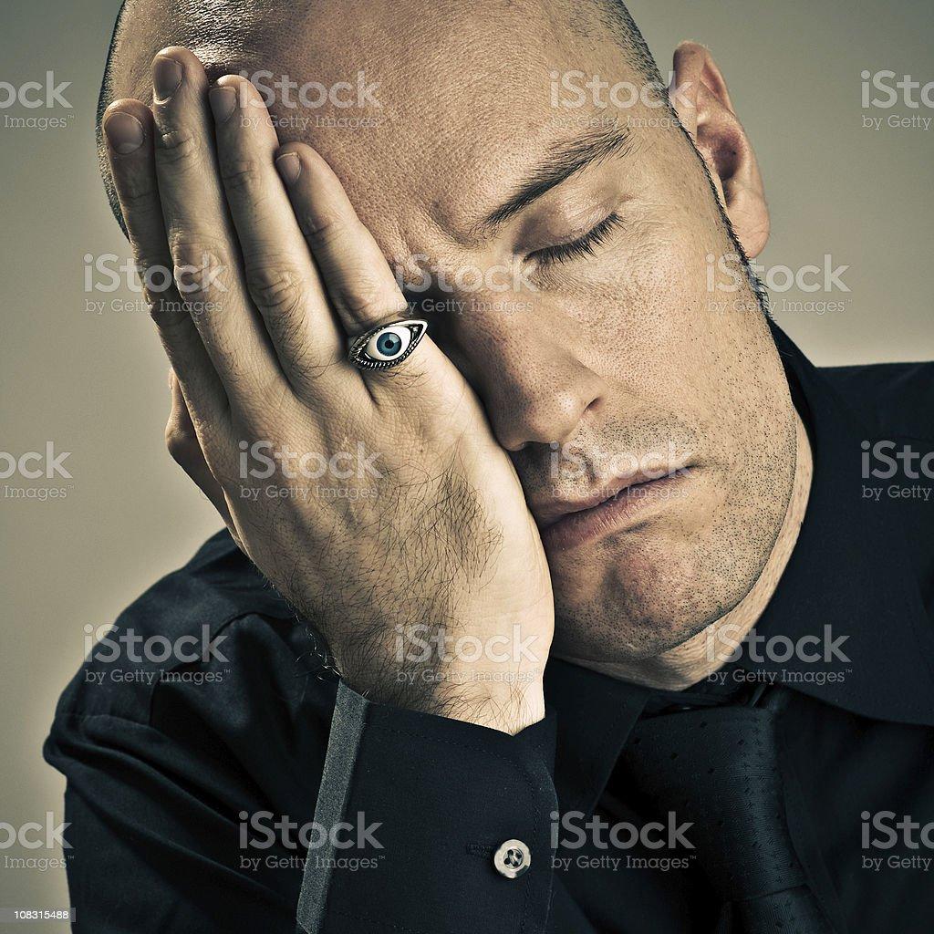 Man sleeping with one eye opened. stock photo