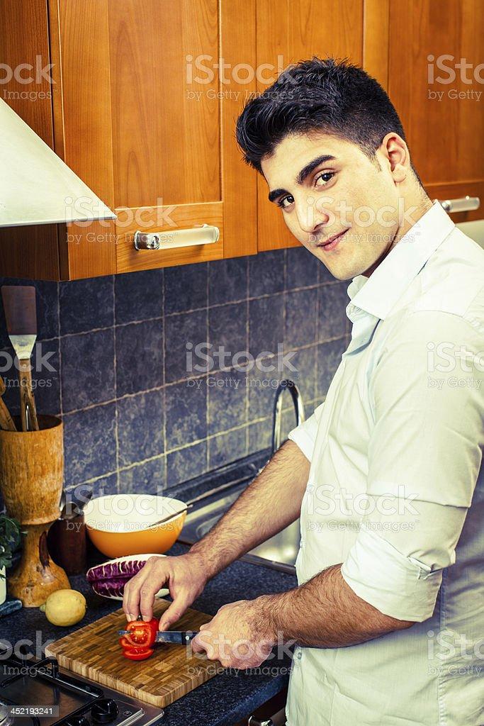 Man Slicing Tomato royalty-free stock photo