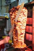 Man slicing turkish doner kebab (kebap)
