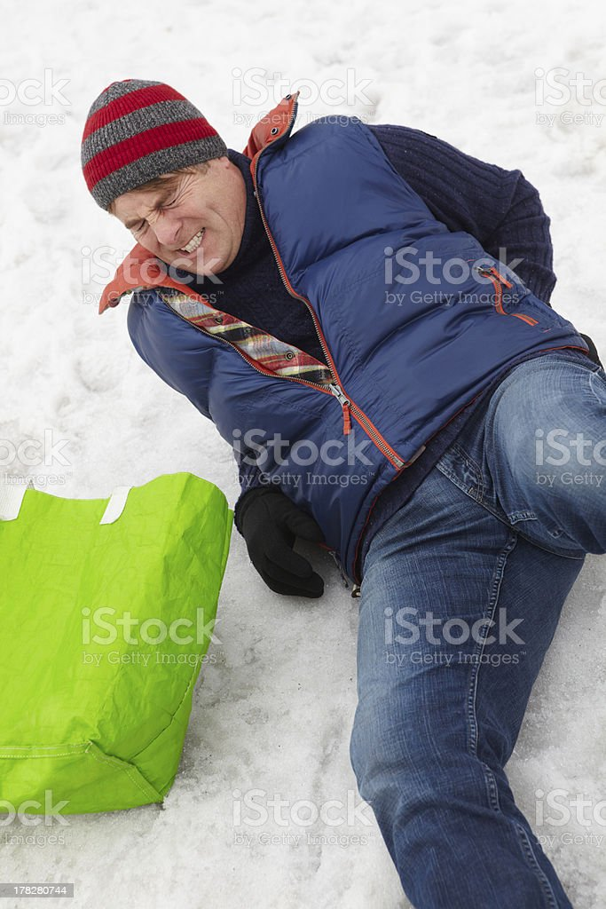 Man Slipped And Injured Back On Icy Street stock photo