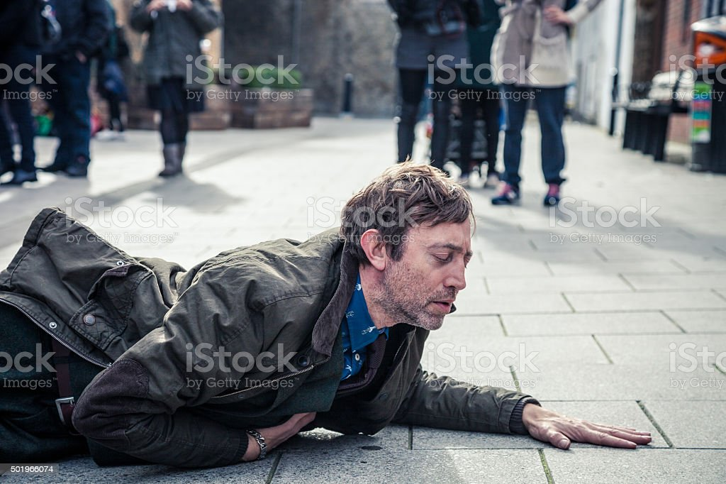 Man slumped to an illness stock photo
