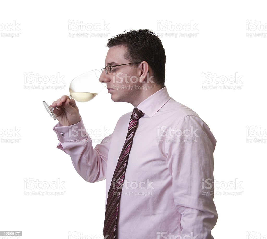 Man smelling a glass of white wine royalty-free stock photo