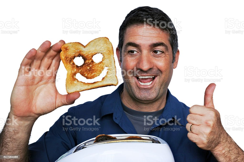 Man smile and holds a good slice of toast stock photo