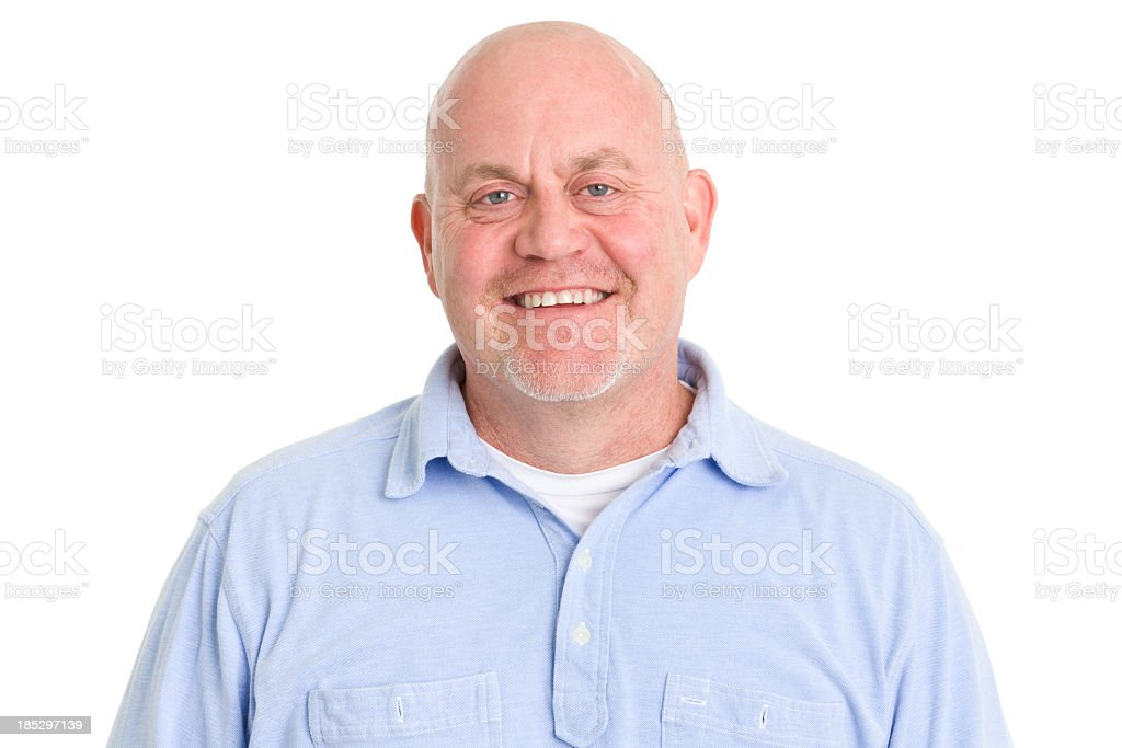 A man smiling for the camera with a bald head royalty-free stock photo