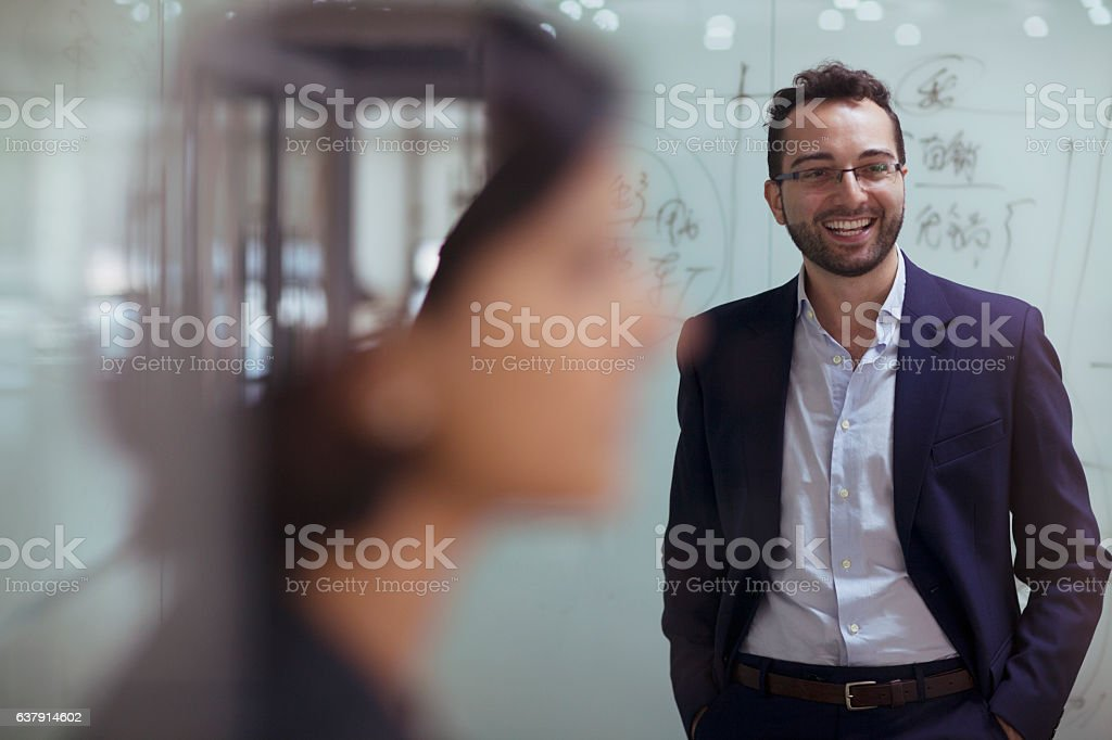 Man smiling in design studio office stock photo