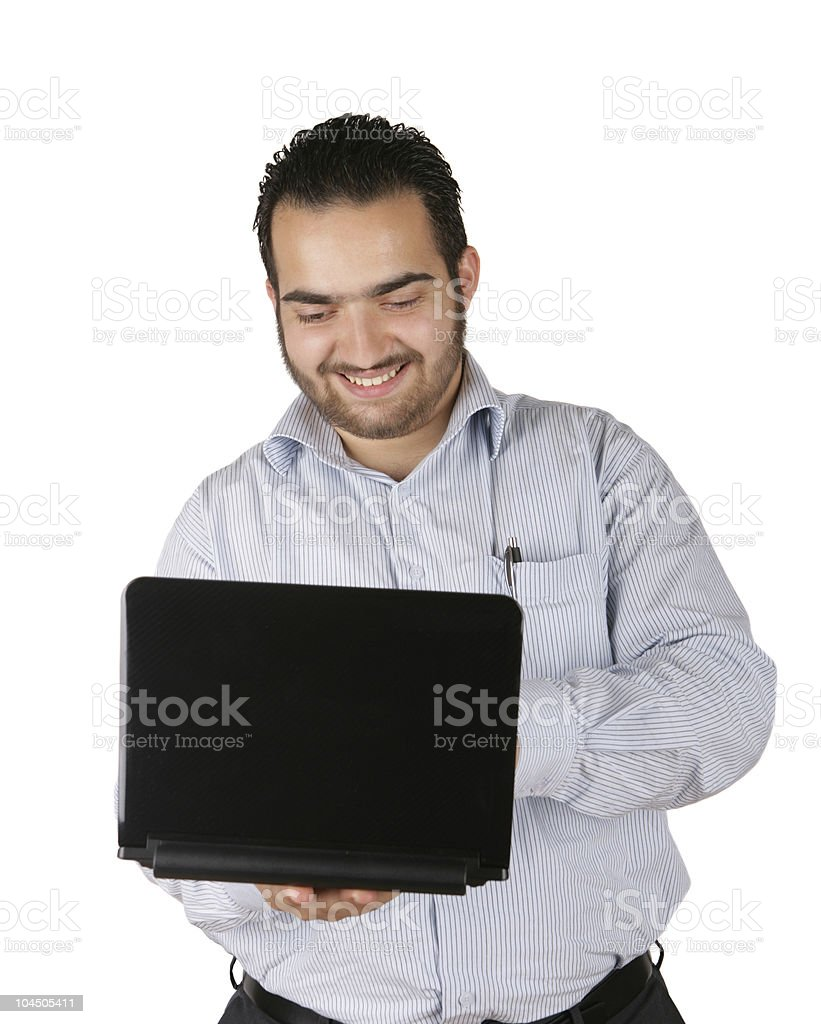 Man smiling while holding a black laptop royalty-free stock photo