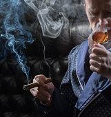 Man smokes a cigar