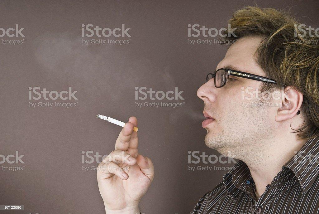 man smokes a cigarette royalty-free stock photo