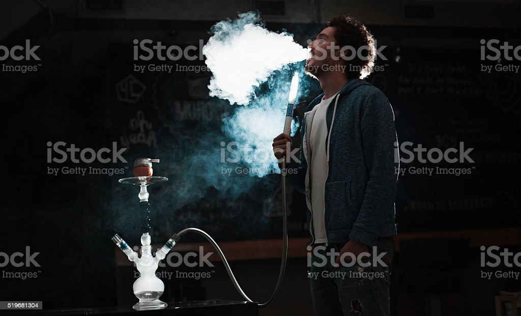 man smokes  hookah stock photo