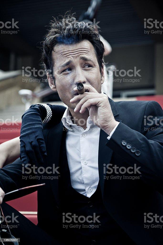 man smoking a cigar stock photo