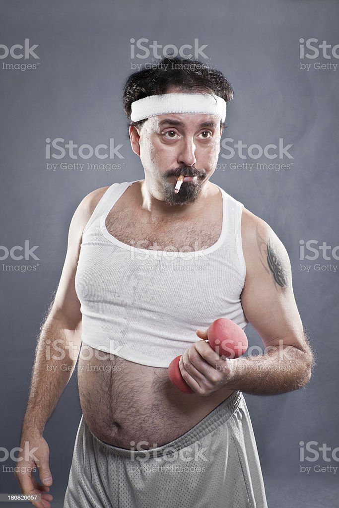 Man Smoking And Working Out royalty-free stock photo