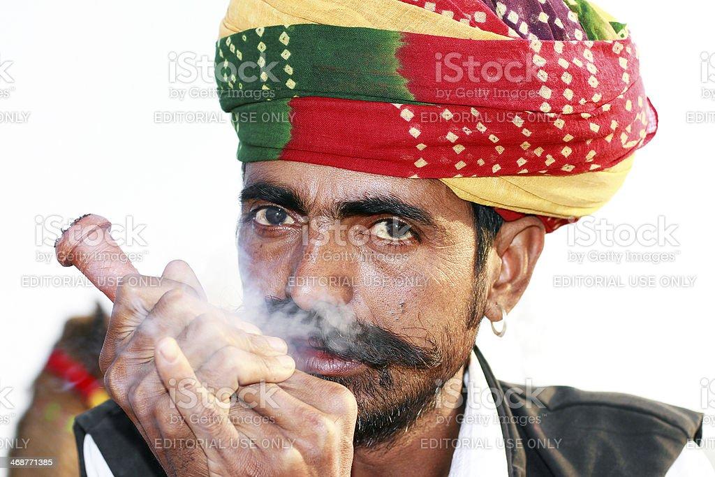 Man smoking at Pushkar fair stock photo