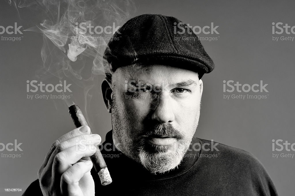 Man smoking cigar stock photo