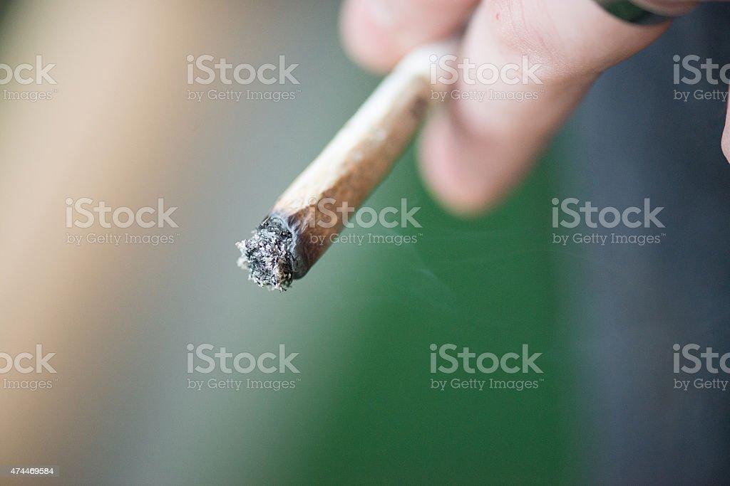 Man smoking marijuana stock photo