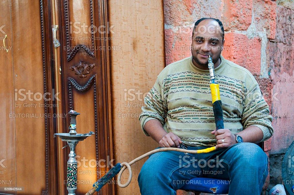Man smoking sheesha in Cairo, Egypt stock photo