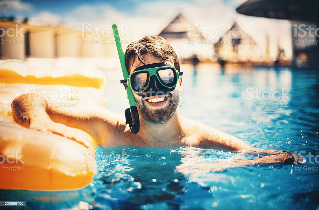 Man snorkeling in a swimming pool stock photo