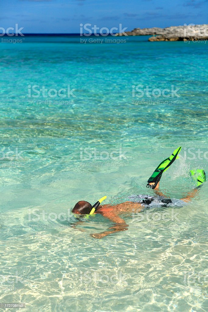 man snorkeling in the Bahamas royalty-free stock photo