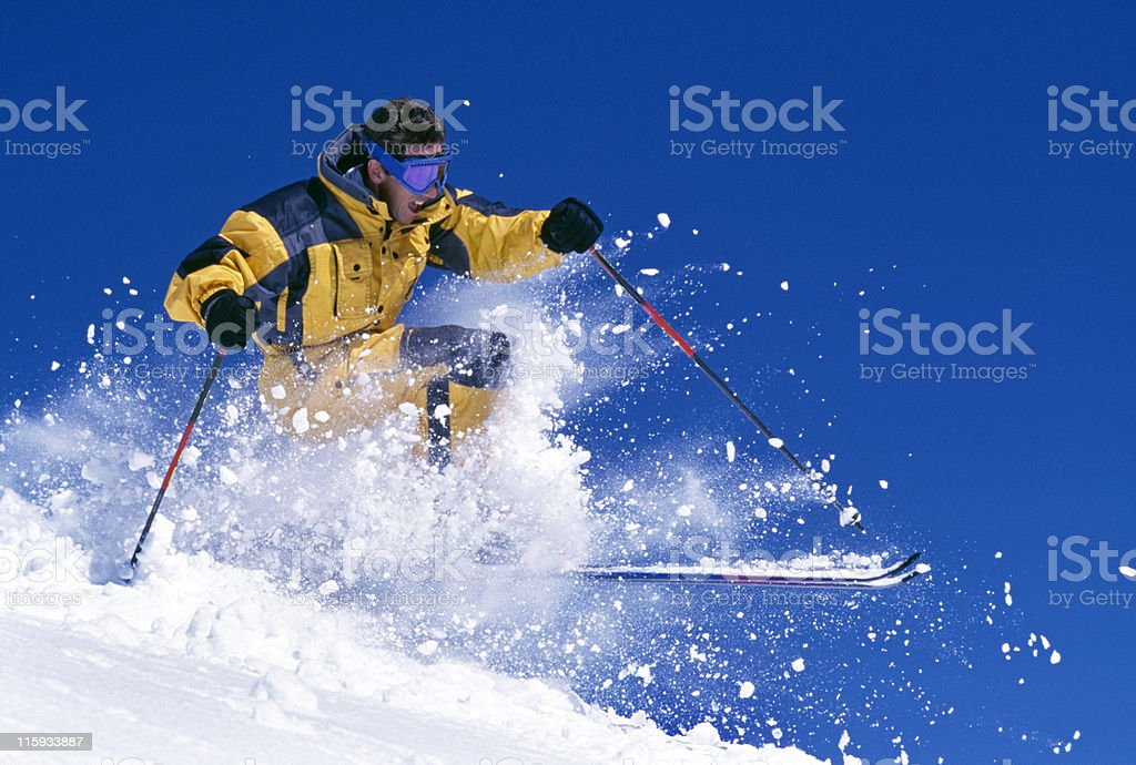 Man Snow Skiing Against Blue Sky royalty-free stock photo