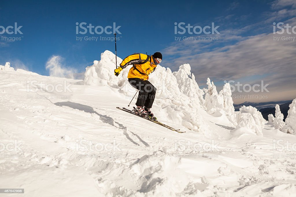 Man Snow Skiing making a jump stock photo
