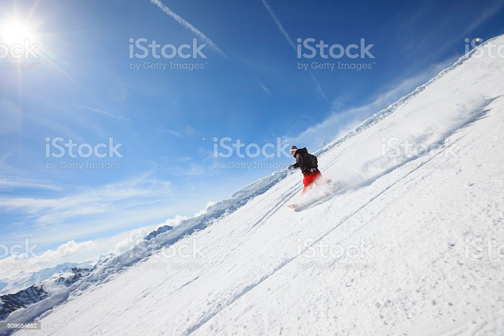 Man snowboarder Snowboarding on the mountain ski slope  France Alps stock photo