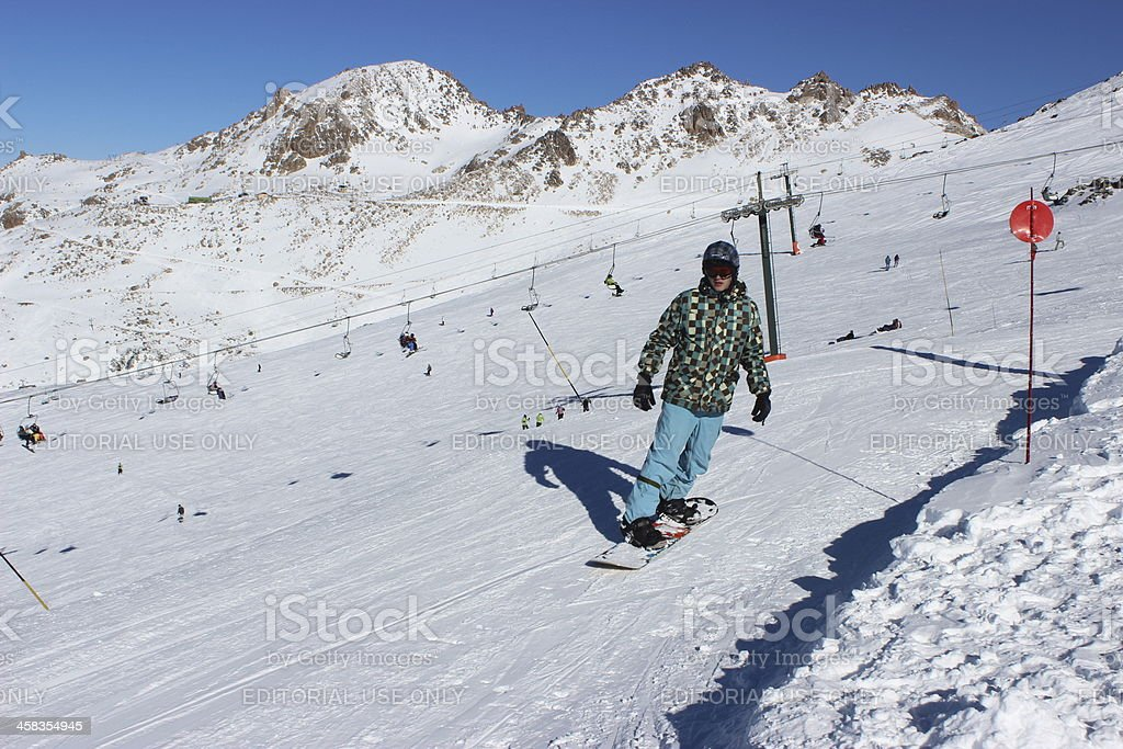 Man snowboarding at ski station CERRO CATEDRAL stock photo