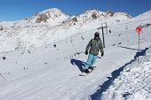 Man snowboarding at ski station CERRO CATEDRAL