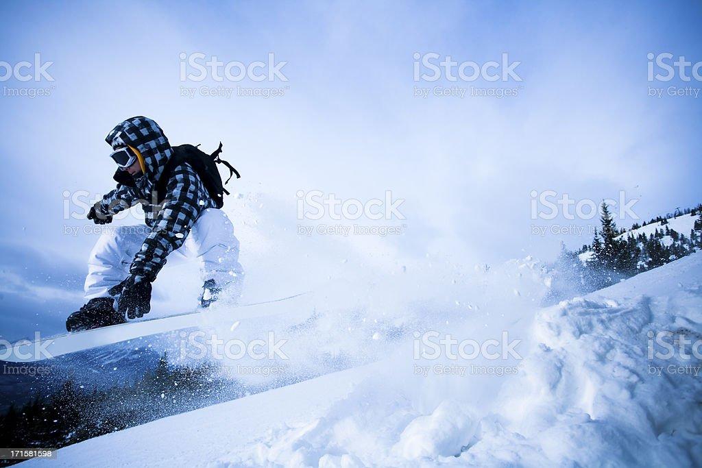 Man snowboarding in the mountain stock photo