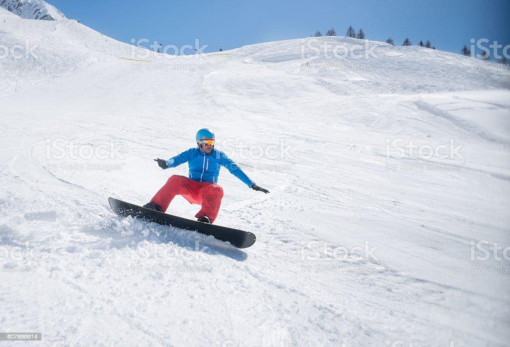 Man snowboarding stock photo