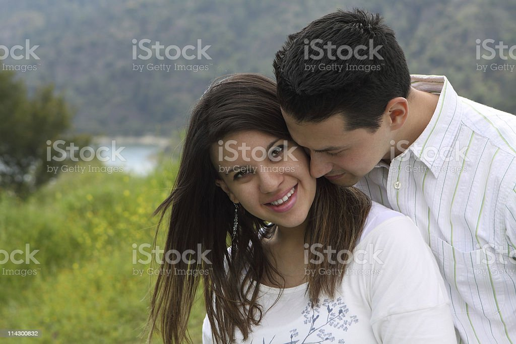 Man Snuggling Attractive Woman royalty-free stock photo