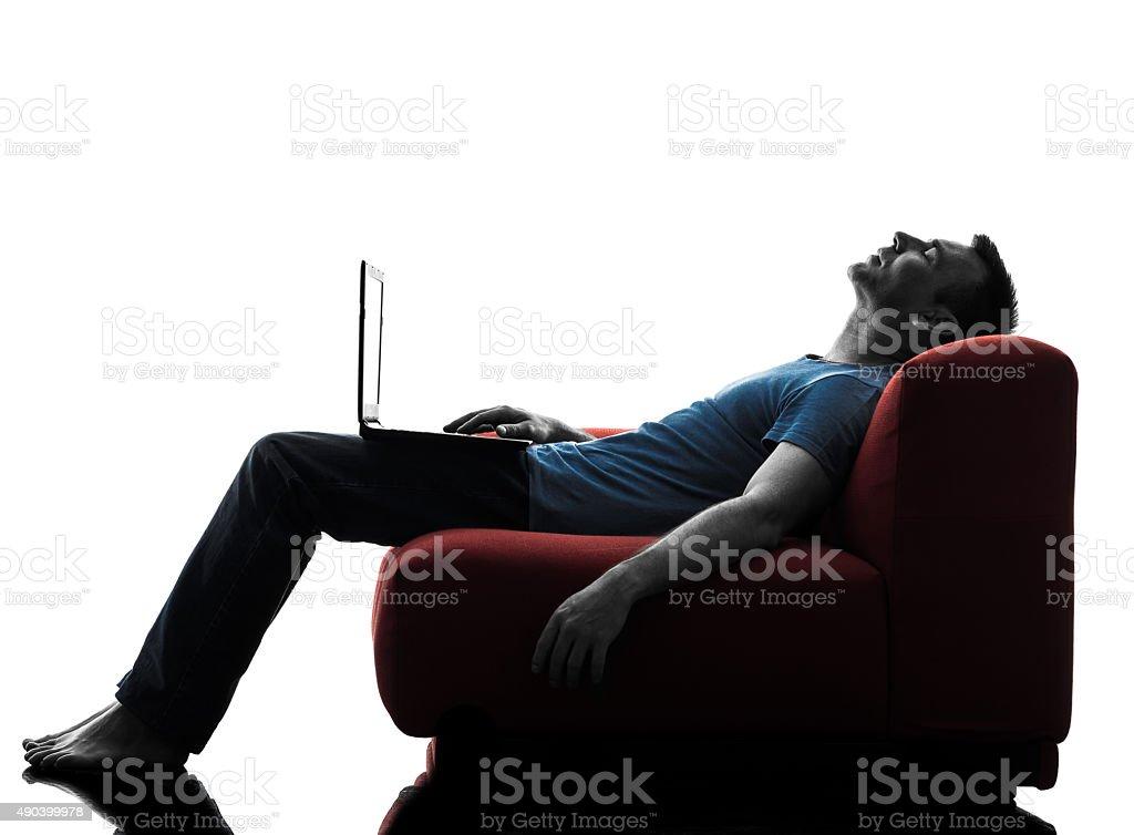 man sofa couch computer computing laptop stock photo