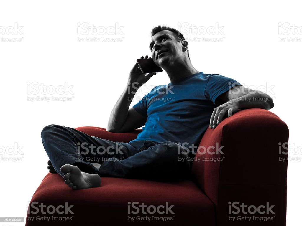 man sofa couch on the telephone stock photo