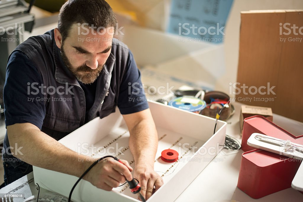 Man soldering electric parts stock photo