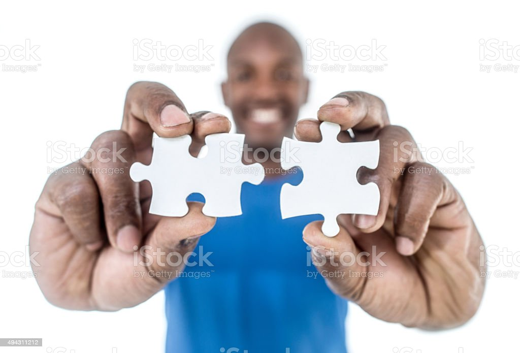 Man solving a puzzle stock photo